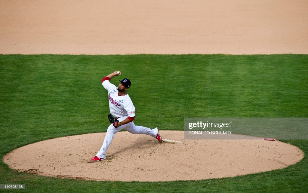 Pitcher Carlos Pimentel of Leones del Escogido of Dominican Republic, pitches against Criollos de Caguas of Puerto Rico, during the 2013 Caribbean baseball series, on February 4, 2013, in Hermosillo, Sonora State, in the northern of Mexico. AFP PHOTO/Ronaldo Schemidt