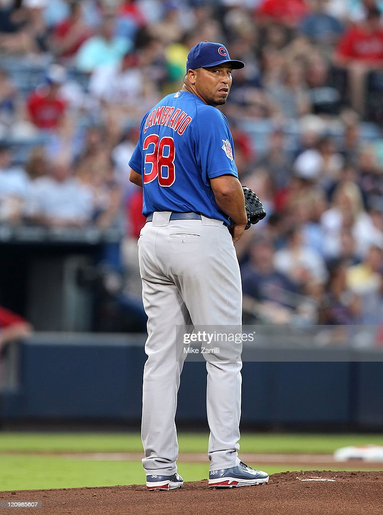 Pitcher Carlos Zambrano #38 of the Chicago Cubs looks to first base during the game against the Atlanta Braves at Turner Field on August 12, 2011 in Atlanta, Georgia.
