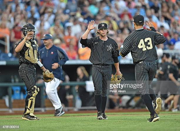 Pitcher Carson Fulmer of the Vanderbilt Commodores celebrates with teammates after the final out against the Virginia Cavaliers in the fourth inning...