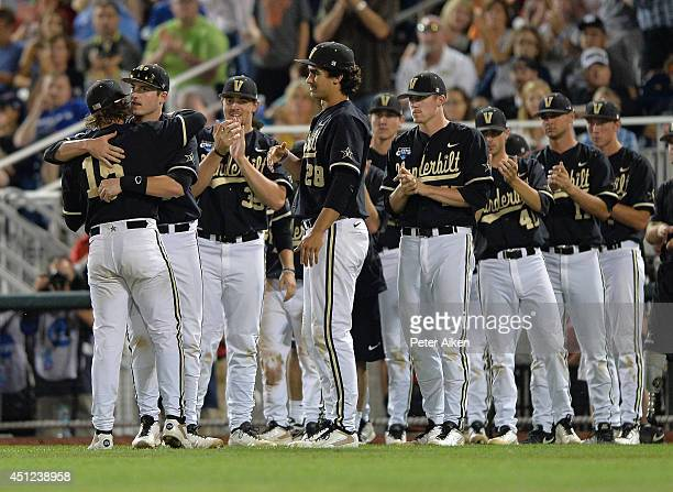 Pitcher Carson Fulmer of the Vanderbilt Commodores gets a hand from his teammates after coming out of the game against the Virginia Cavaliers in the...