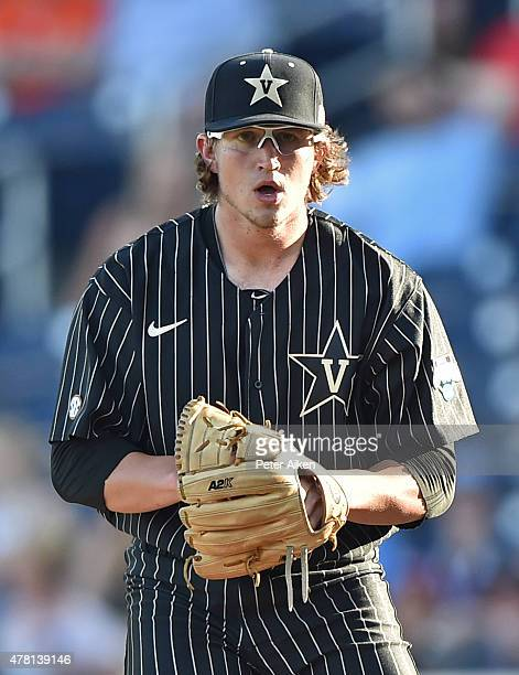 Pitcher Carson Fulmer of the Vanderbilt Commodores gets set to deliver a pitch against the Virginia Cavaliers in the first inning during game one of...