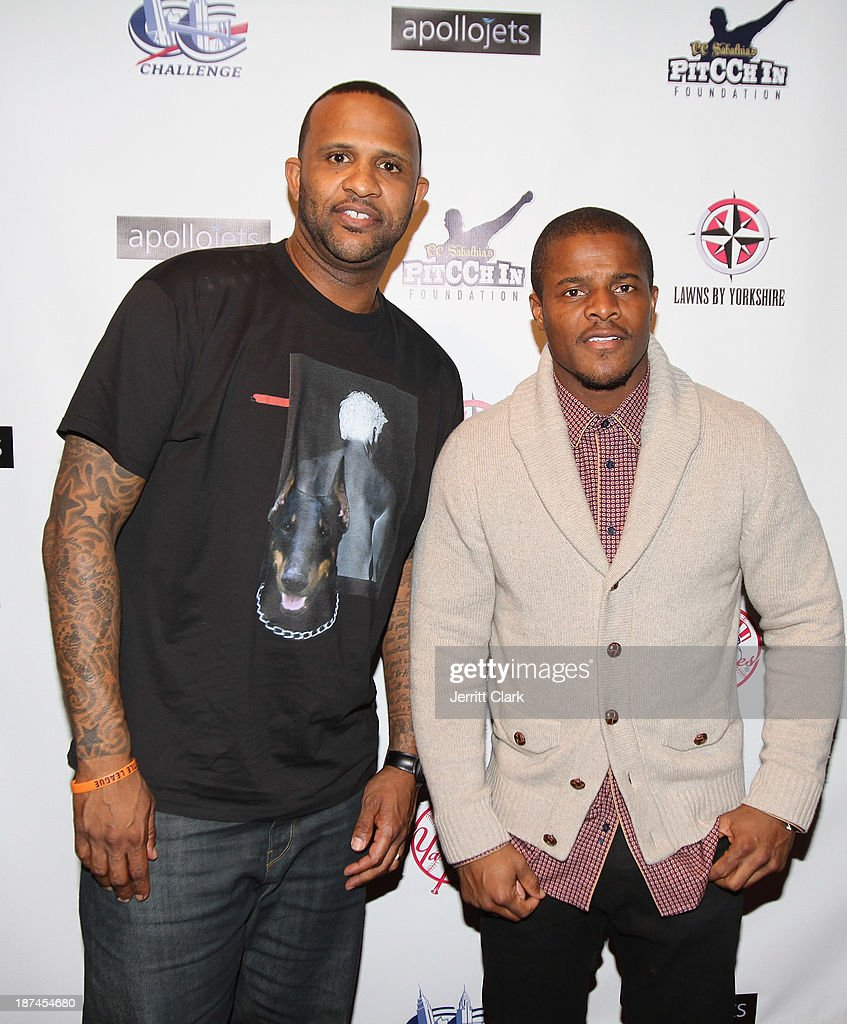Pitcher C.C. Sabathia and Boxer Hino Ehikhamenor attend the PitCCh In Foundation 2013 Challenge Rules Party at Luxe at Lucky Strike Lanes on November 8, 2013 in New York City.