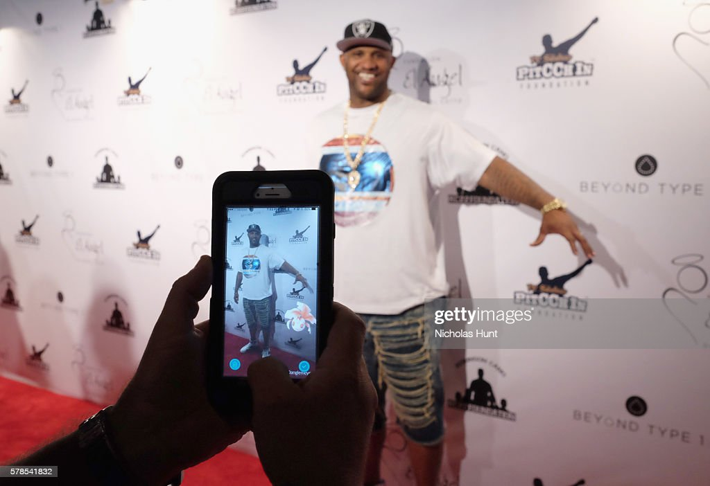 MLB pitcher CC Sabathia engages with the Pokemon Go app at the Roc Nation Summer Classic Charity Basketball Tournament at Barclays Center of Brooklyn on July 21, 2016 in New York City.