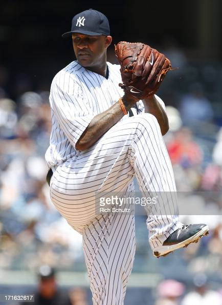 Pitcher CC Sabathia of the New York Yankees delivers a pitch against the Tampa Bay Rays in a MLB baseball game at Yankee Stadium on June 22 2013 in...