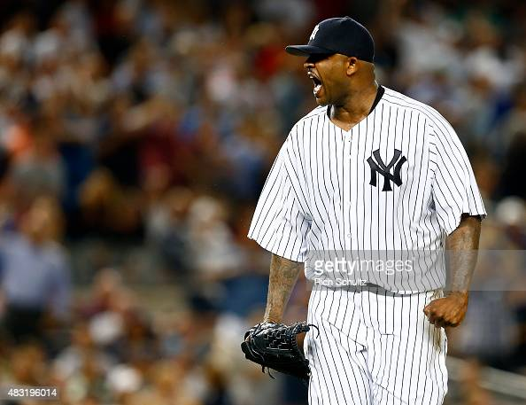 Pitcher CC Sabathia of the New York Yankees reacts after striking out David Ortiz of the Boston Red Sox to end the fifth inning during a MLB baseball...
