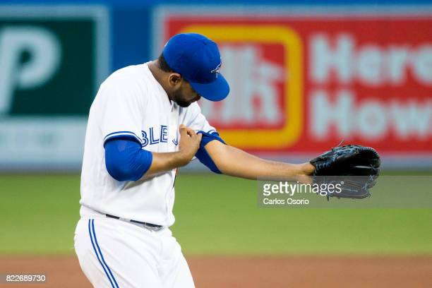 TORONTO ON JULY 25 Pitcher Cesar Valdez of the Blue Jays checks his left arm after getting hit with a comebacker during the 4th inning of MLB action...