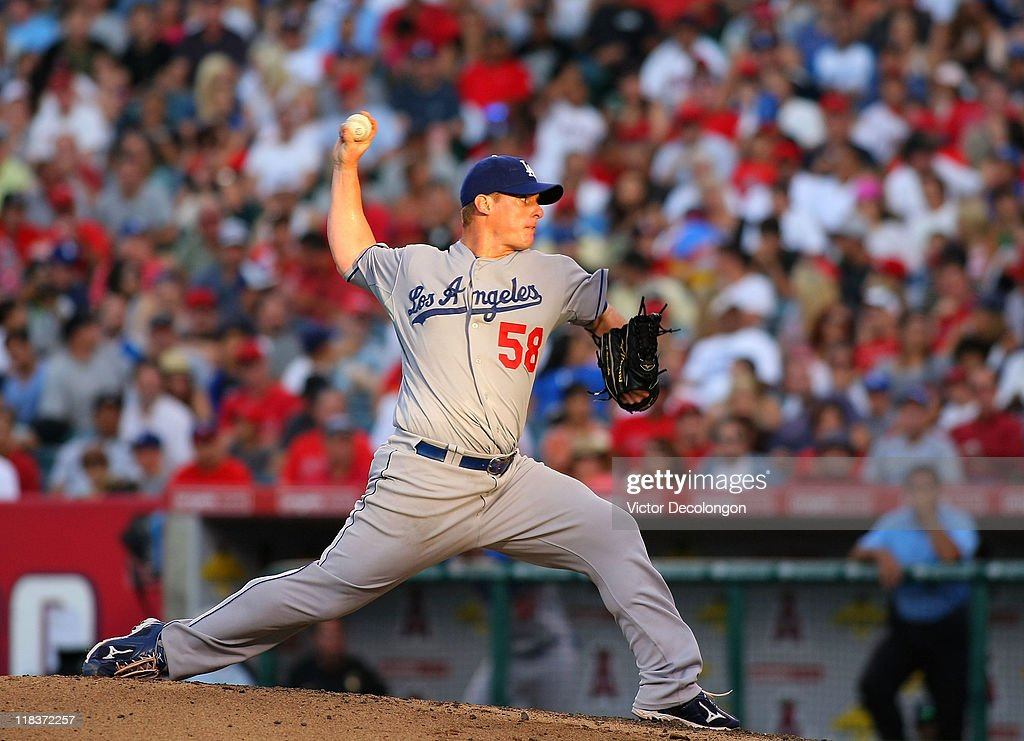 Pitcher <a gi-track='captionPersonalityLinkClicked' href=/galleries/search?phrase=Chad+Billingsley&family=editorial&specificpeople=533047 ng-click='$event.stopPropagation()'>Chad Billingsley</a> #58 of the Los Angeles Dodgers pitches during their MLB game against the Los Angeles Angels of Anaheim at Angel Stadium of Anaheim on July 3, 2011 in Anaheim, California. The Angels defeated the Dodgers 3-1.