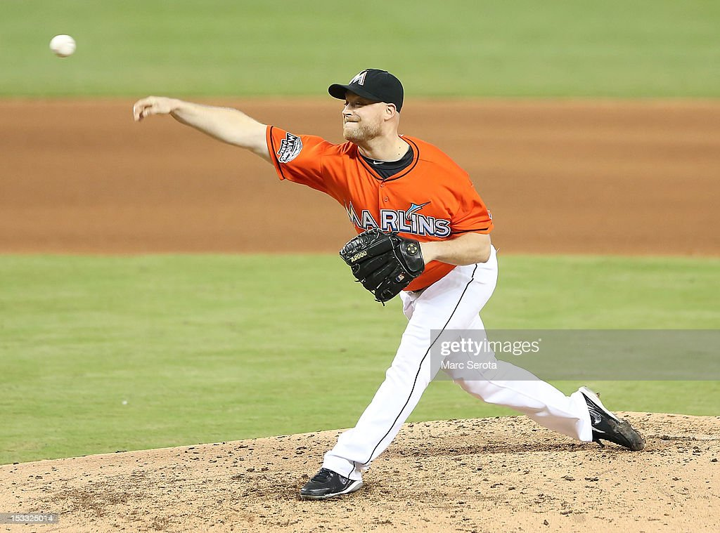 Pitcher <a gi-track='captionPersonalityLinkClicked' href=/galleries/search?phrase=Chad+Gaudin&family=editorial&specificpeople=3011132 ng-click='$event.stopPropagation()'>Chad Gaudin</a> #57 of the Miami Marlins throws against the New York Mets at Marlins Park on October 3, 2012 in Miami, Florida.