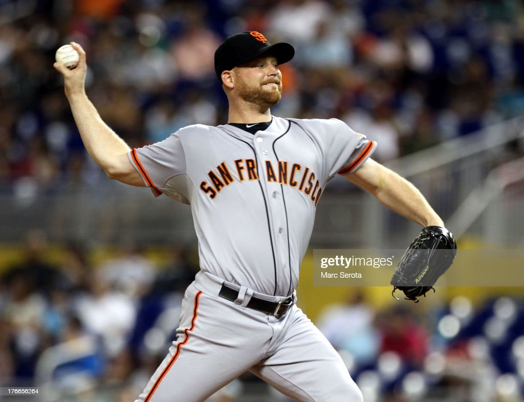 Pitcher <a gi-track='captionPersonalityLinkClicked' href=/galleries/search?phrase=Chad+Gaudin&family=editorial&specificpeople=3011132 ng-click='$event.stopPropagation()'>Chad Gaudin</a> #57 of the San Francisco Giants throws against the Miami Marlins at Marlins Park on August 16, 2013 in Miami, Florida.