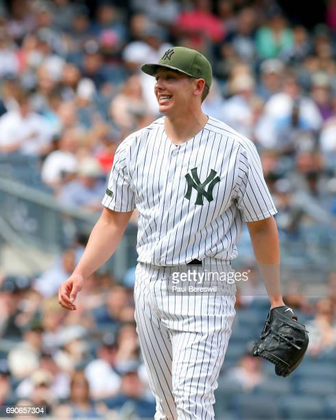 Pitcher Chad Green of the New York Yankees smiles after getting out Mark Canha to end the 7th inning during an MLB baseball game against the Oakland...