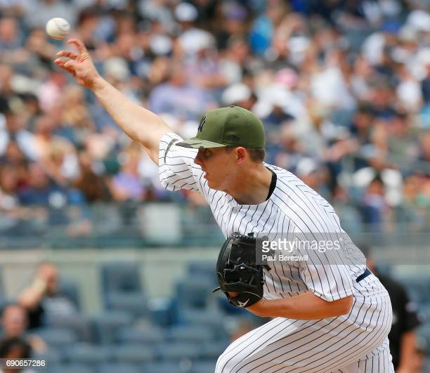 Pitcher Chad Green of the New York Yankees throws a pitch during an MLB baseball game against the Oakland Athletics on May 28 2017 at Yankee Stadium...
