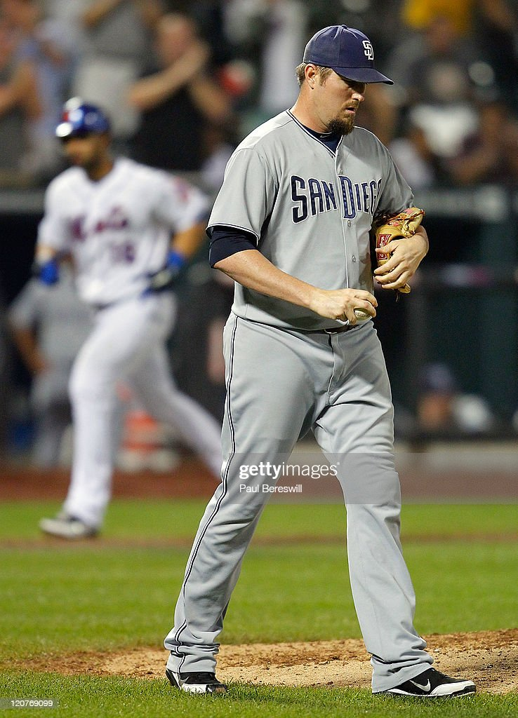 Pitcher Chad Qualls #50 of the San Diego Padres paces around the mound in the eighth inning of a Major League Baseball game as Angel Pagan #16 of the New York Mets runs home with his home run at Citi Field on August 9, 2011 in the Flushing neighborhood of the Queens borough of New York City.
