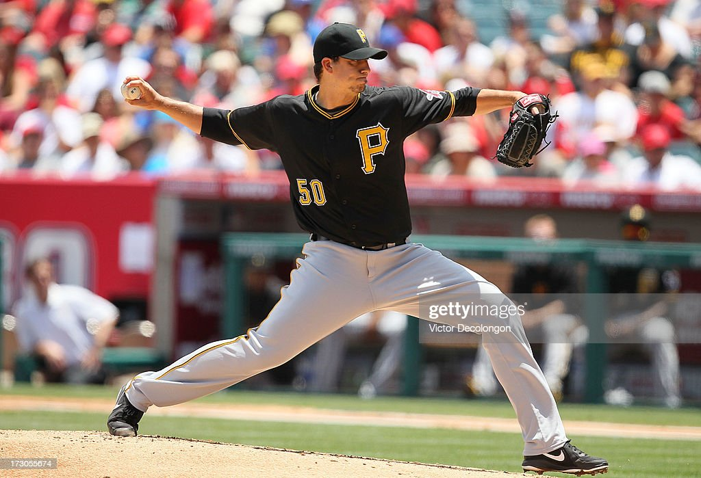 Pitcher Charlie Morton #50 of the Pittsburgh Pirates pitches against the Los Angeles Angels of Anaheim during the MLB game at Angel Stadium of Anaheim on June 23, 2013 in Anaheim, California. The Pirates defeated the Angels 10-9 in ten innings.