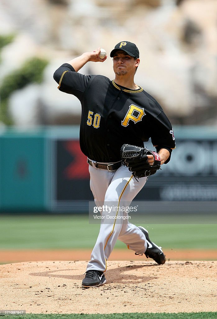 Pitcher Charlie Morton #50 of the Pittsburgh Pirates pitches in the first inning during the MLB game against the Los Angeles Angels of Anaheim at Angel Stadium of Anaheim on June 23, 2013 in Anaheim, California. The Pirates defeated the Angels 10-9 in ten innings.