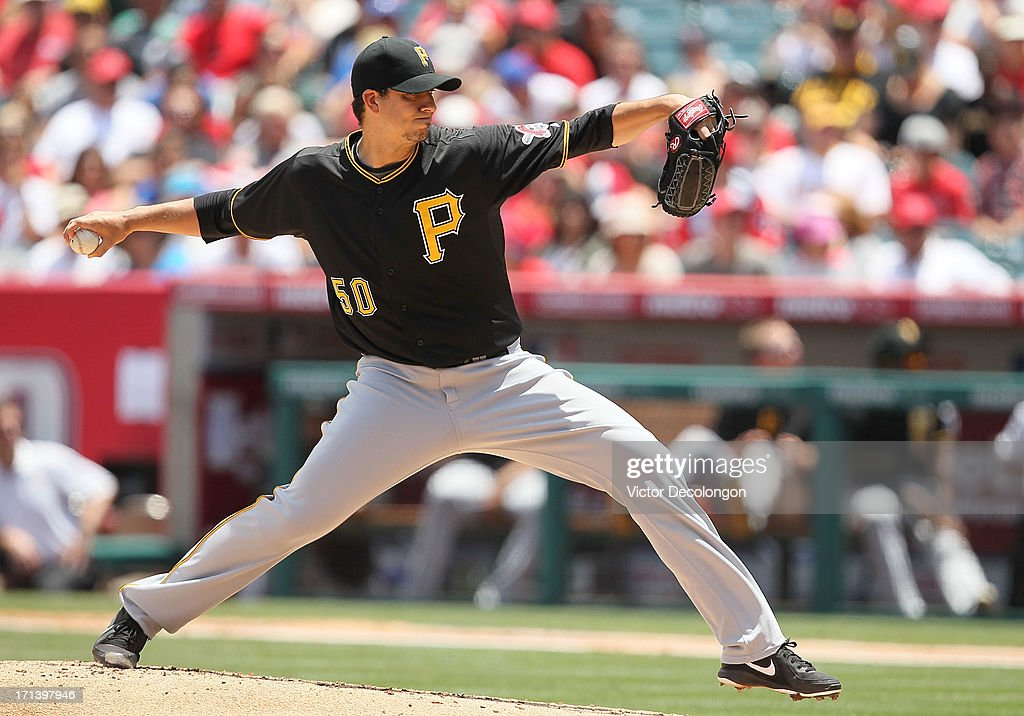 Pitcher Charlie Morton #50 of the Pittsburgh Pirates pitches in the second inning during the MLB game against the Los Angeles Angels of Anaheim at Angel Stadium of Anaheim on June 23, 2013 in Anaheim, California. The Pirates defeated the Angels 10-9 in ten innings.