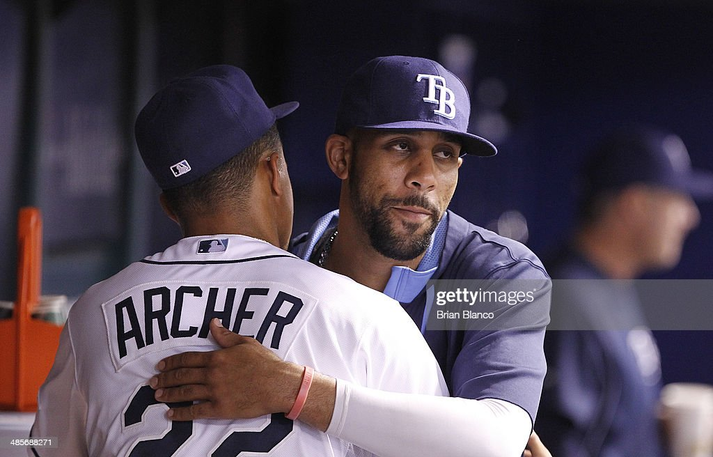 Pitcher Chris Archer (L) #22 of the Tampa Bay Rays gets a hug from fellow pitcher David Price #14 of the Tampa Bay Rays as he comes out of the game during the seventh inning of a game against the New York Yankees on April 19, 2014 at Tropicana Field in St. Petersburg, Florida.
