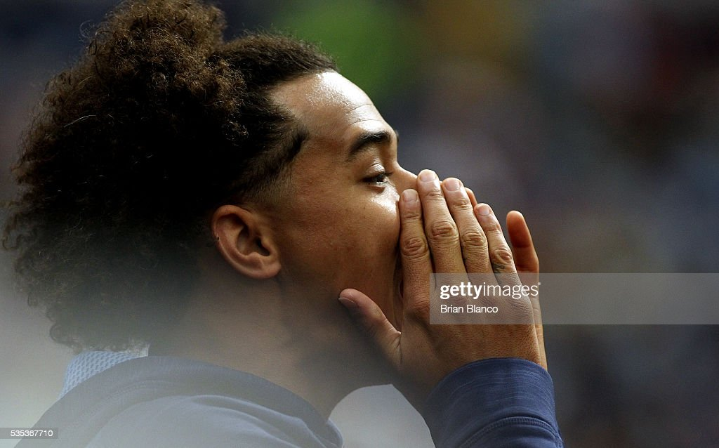 Pitcher <a gi-track='captionPersonalityLinkClicked' href=/galleries/search?phrase=Chris+Archer+-+Baseball+Player&family=editorial&specificpeople=12544049 ng-click='$event.stopPropagation()'>Chris Archer</a> #22 of the Tampa Bay Rays cheers from the dugout as he celebrates the single by teammate Logan Morrison during the sixth inning of a game on May 29, 2016 at Tropicana Field in St. Petersburg, Florida.
