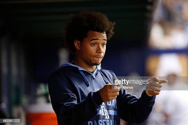 Pitcher Chris Archer of the Tampa Bay Rays gestures as he speaks with teammates in the dugout during the fifth inning of a game against the New York...