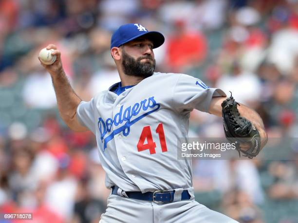 Pitcher Chris Hatcher of the Los Angeles Dodgers throws a pitch in the seventh inning of a game on June 15 2017 against the Cleveland Indians at...