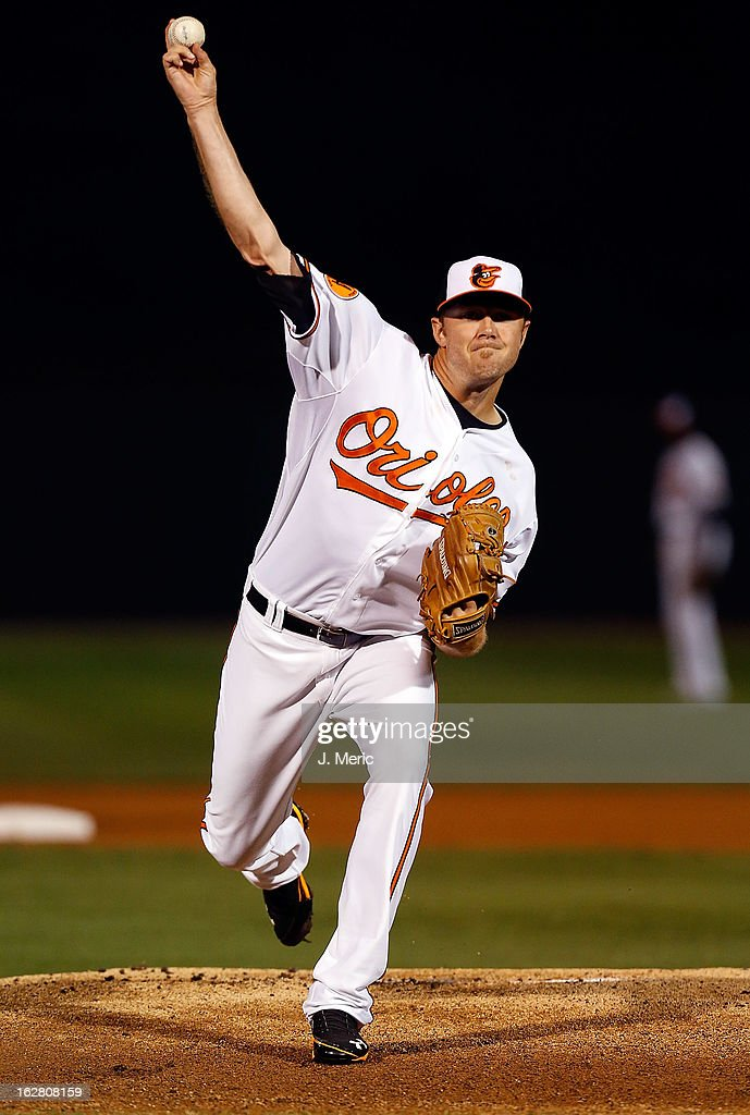 Pitcher Chris Tillman #30 of the Baltimore Orioles pitches against the Boston Red Sox during a Grapefruit League Spring Training Game at Ed Smith Stadium on February 27, 2013 in Sarasota, Florida.