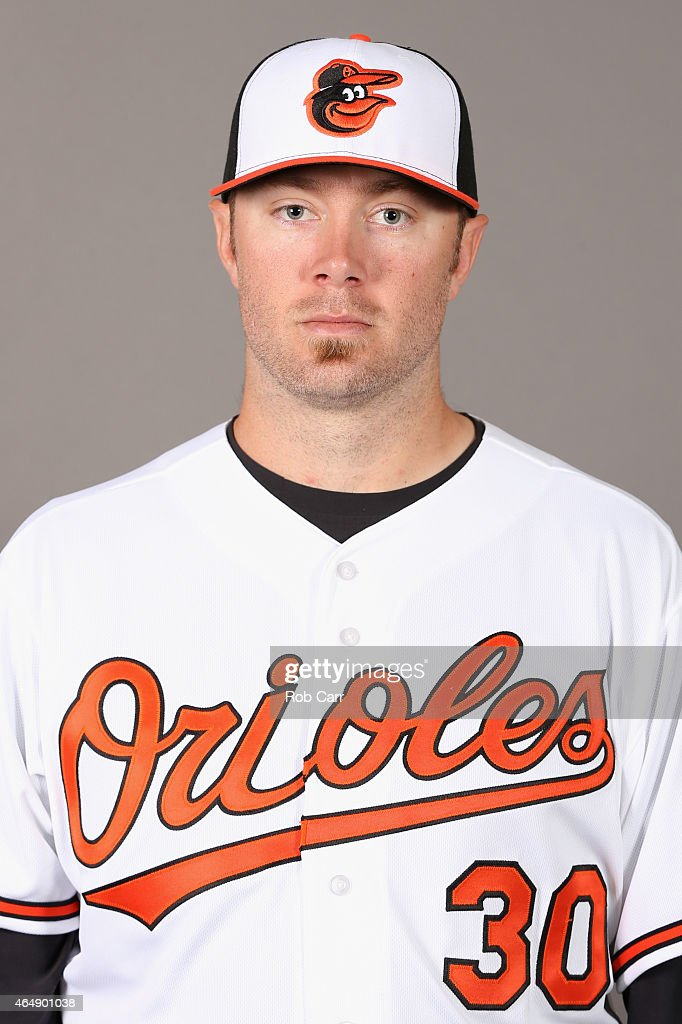 Pitcher <a gi-track='captionPersonalityLinkClicked' href=/galleries/search?phrase=Chris+Tillman&family=editorial&specificpeople=713179 ng-click='$event.stopPropagation()'>Chris Tillman</a> #30 of the Baltimore Orioles poses on photo day at Ed Smith Stadium on March 1, 2015 in Sarasota, Florida.