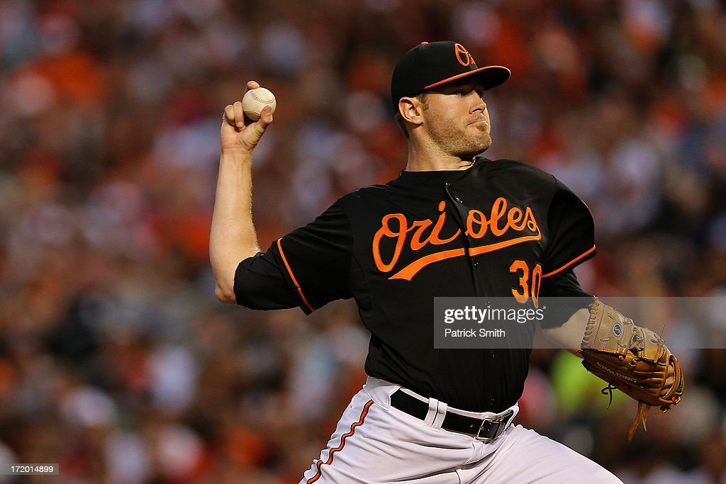 Pitcher Chris Tillman #30 of the Baltimore Orioles works the first inning against the New York Yankees at Oriole Park at Camden Yards on June 30, 2013 in Baltimore, Maryland.