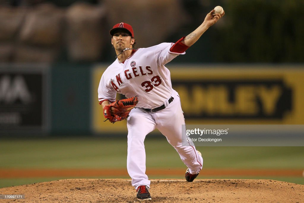 Pitcher C.J. Wilson #33 of the Los Angeles Angels of Anaheim pitches against the Seattle during the MLB game at Angel Stadium of Anaheim on June 19, 2013 in Anaheim, California. The Angels defeated the Mariners 1-0.