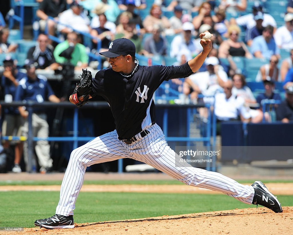 Pitcher <a gi-track='captionPersonalityLinkClicked' href=/galleries/search?phrase=Clay+Rapada&family=editorial&specificpeople=4175087 ng-click='$event.stopPropagation()'>Clay Rapada</a> #39 of the New York Yankees throws in relief against the New York Mets in a spring training game April 4, 2012 at George M. Steinbrenner Field in Tampa, Florida.