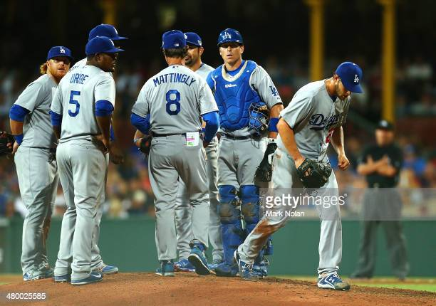 Pitcher Clayton Kershaw of the Dodgers is taken out of the game during the opening match of the MLB season between the Los Angeles Dodgers and the...