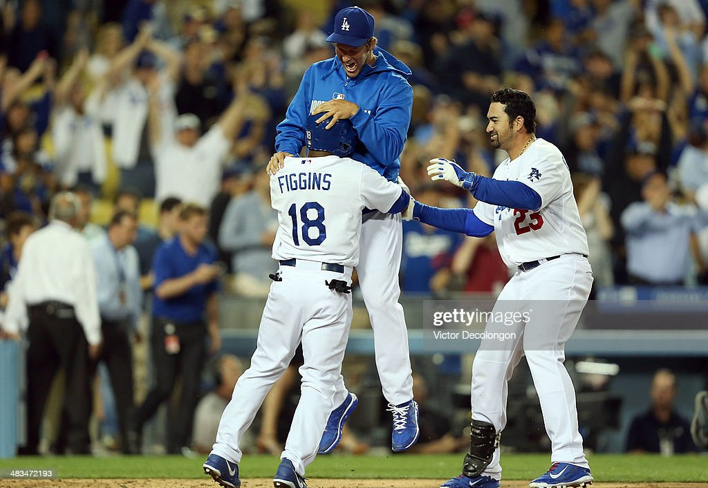 Pitcher <a gi-track='captionPersonalityLinkClicked' href=/galleries/search?phrase=Clayton+Kershaw&family=editorial&specificpeople=4391635 ng-click='$event.stopPropagation()'>Clayton Kershaw</a> #22 of the Los Angeles Dodgers jumps on teammate <a gi-track='captionPersonalityLinkClicked' href=/galleries/search?phrase=Chone+Figgins&family=editorial&specificpeople=203278 ng-click='$event.stopPropagation()'>Chone Figgins</a> #18 after Figgins scored the game-winning run in the 10th inning on a double by Carl Crawford #3 of the Los Angeles Dodgers (not in photo) against pitcher Phil Coke #40 of the Detroit Tigers (not in photo) as teammate Adrian Gonzalez #23 joins the celebration after their MLB game at Dodger Stadium on April 8, 2014 in Los Angeles, California. The Dodgers defeated the Tigers 3-2 in 10 innings.