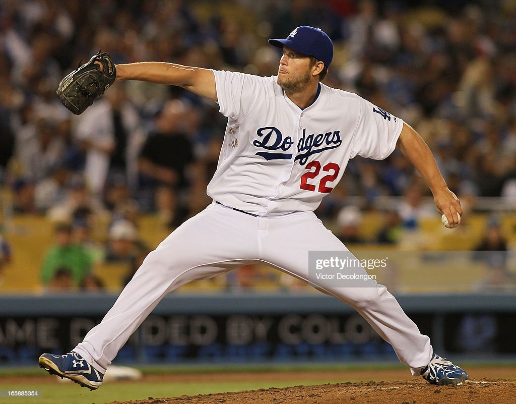 Pitcher <a gi-track='captionPersonalityLinkClicked' href=/galleries/search?phrase=Clayton+Kershaw&family=editorial&specificpeople=4391635 ng-click='$event.stopPropagation()'>Clayton Kershaw</a> #22 of the Los Angeles Dodgers pitches in the seventh inning during the MLB game against the PIttsburgh Pirates at Dodger Stadium on April 6, 2013 in Los Angeles, California. The Dodgers defeated the Pirates 1-0.