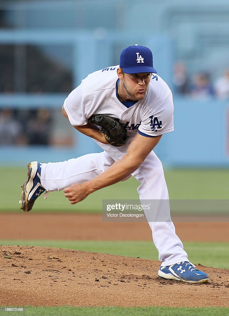 Pitcher <a gi-track='captionPersonalityLinkClicked' href=/galleries/search?phrase=Clayton+Kershaw&family=editorial&specificpeople=4391635 ng-click='$event.stopPropagation()'>Clayton Kershaw</a> #22 of the Los Angeles Dodgers pitches in the second inning during the MLB game against the PIttsburgh Pirates at Dodger Stadium on April 6, 2013 in Los Angeles, California. The Dodgers defeated the Pirates 1-0.