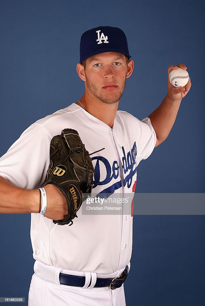 Pitcher <a gi-track='captionPersonalityLinkClicked' href=/galleries/search?phrase=Clayton+Kershaw&family=editorial&specificpeople=4391635 ng-click='$event.stopPropagation()'>Clayton Kershaw</a> #22 of the Los Angeles Dodgers poses for a portrait during spring training photo day at Camelback Ranch on February 17, 2013 in Glendale, Arizona.