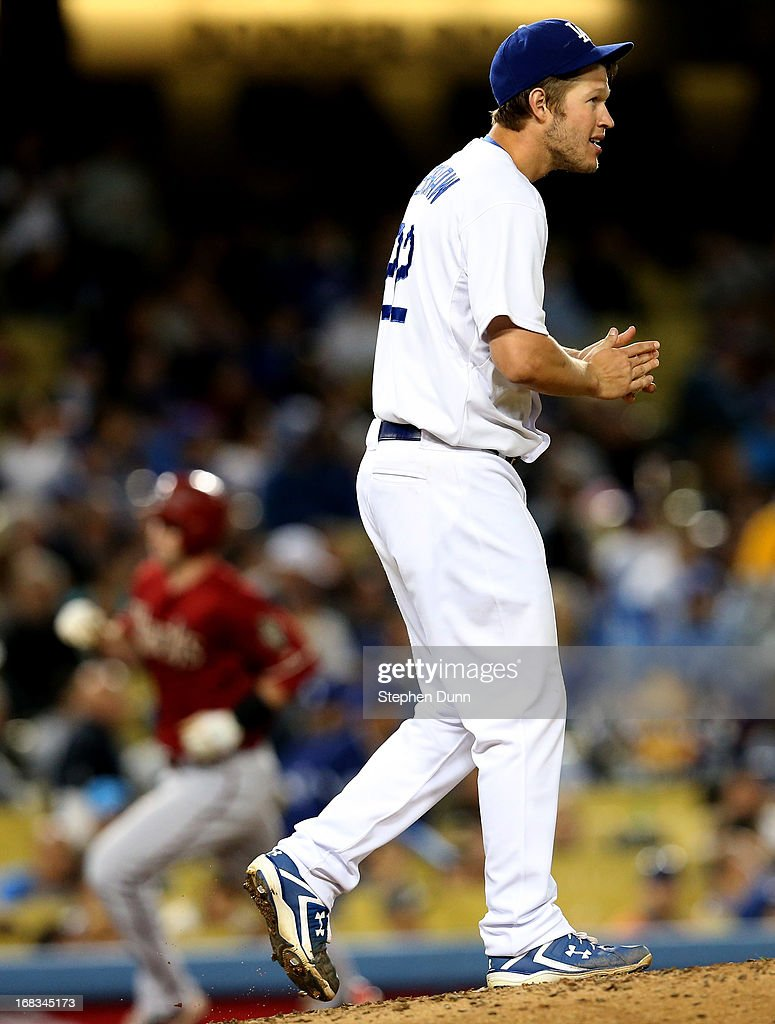 Pitcher <a gi-track='captionPersonalityLinkClicked' href=/galleries/search?phrase=Clayton+Kershaw&family=editorial&specificpeople=4391635 ng-click='$event.stopPropagation()'>Clayton Kershaw</a> #22 of the Los Angeles Dodgers reacts after giving up a two run home run to <a gi-track='captionPersonalityLinkClicked' href=/galleries/search?phrase=Paul+Goldschmidt&family=editorial&specificpeople=7511120 ng-click='$event.stopPropagation()'>Paul Goldschmidt</a> #44 of the Arizona Diamondbacks in the sixth inning at Dodger Stadium on May 8, 2013 in Los Angeles, California.