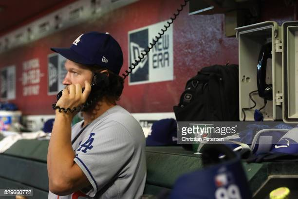 Pitcher Clayton Kershaw of the Los Angeles Dodgers talks on the bullpen phone during the MLB game against the Arizona Diamondbacks at Chase Field on...