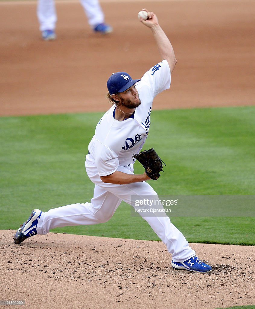 Pitcher Clayton Kershaw of the Los Angeles Dodgers throws a strike against Melvin Upton Jr #2 of the San Diego Padres to record his 300th season...