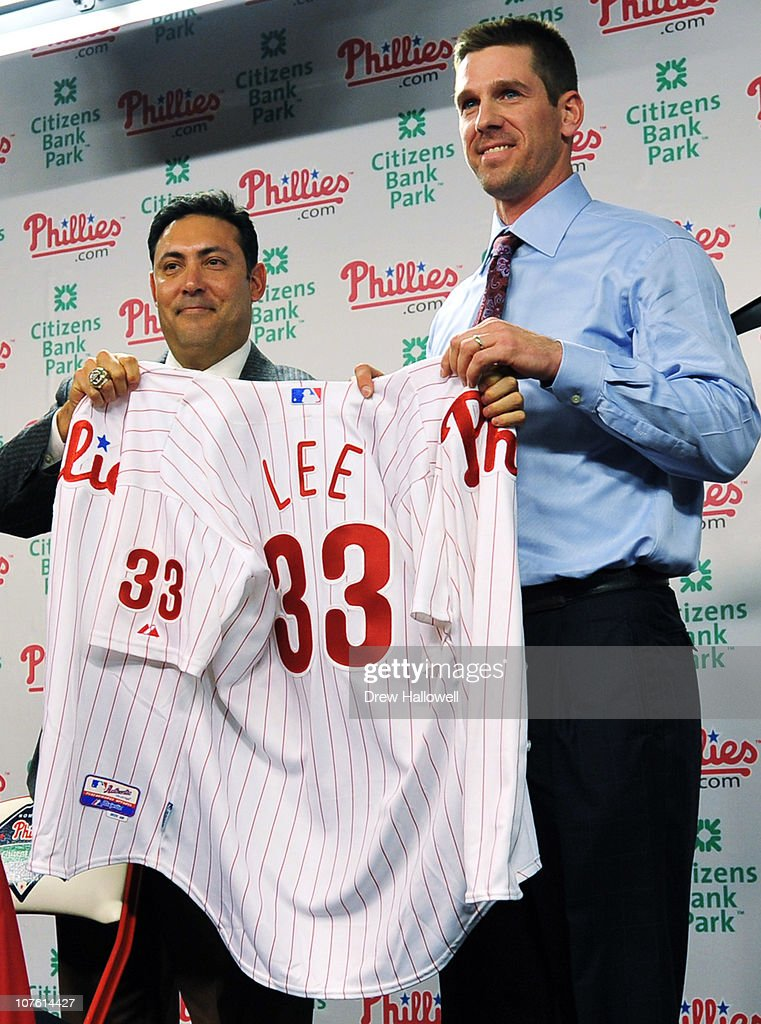 Pitcher <a gi-track='captionPersonalityLinkClicked' href=/galleries/search?phrase=Cliff+Lee&family=editorial&specificpeople=218092 ng-click='$event.stopPropagation()'>Cliff Lee</a> (R) #33 of the Philadelphia Phillies is introduced to the media and presented his jersey by the Philadelphia Phillies general manager Ruben Amaro Jr. during a press conference at Citizens Bank Park on December 15, 2010 in Philadelphia, Pennsylvania.