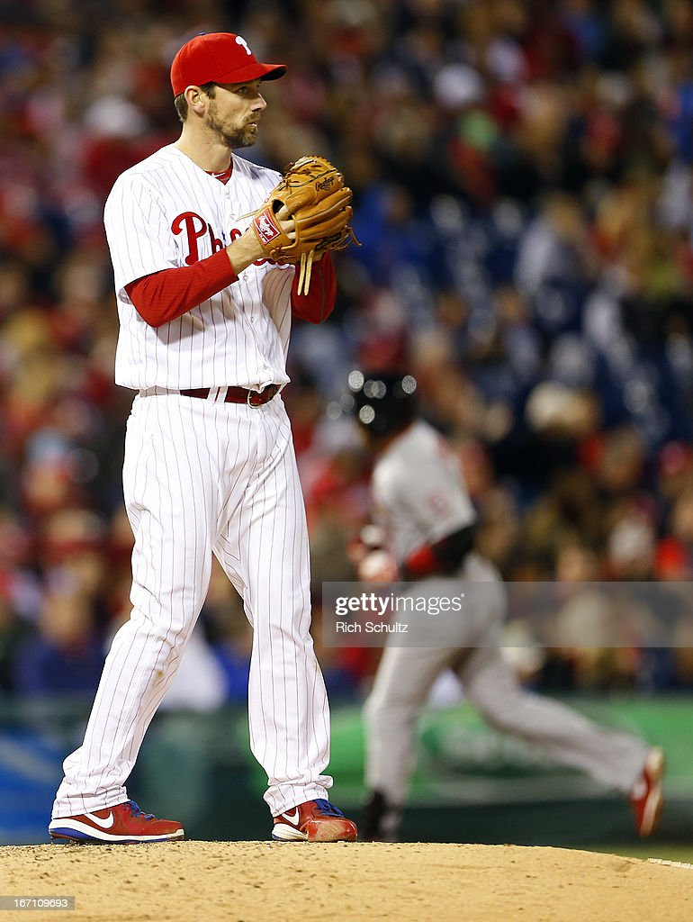 Pitcher <a gi-track='captionPersonalityLinkClicked' href=/galleries/search?phrase=Cliff+Lee&family=editorial&specificpeople=218092 ng-click='$event.stopPropagation()'>Cliff Lee</a> #33 of the Philadelphia Phillies stares into the outfield as <a gi-track='captionPersonalityLinkClicked' href=/galleries/search?phrase=Carlos+Beltran&family=editorial&specificpeople=167108 ng-click='$event.stopPropagation()'>Carlos Beltran</a> #3 of the St. Louis Cardinals rounds third base after hitting a home run in the fifth inning in a MLB baseball game on April 20, 2013 at Citizens Bank Park in Philadelphia, Pennsylvania. The Cardinals defeated the Phillies 5-0.