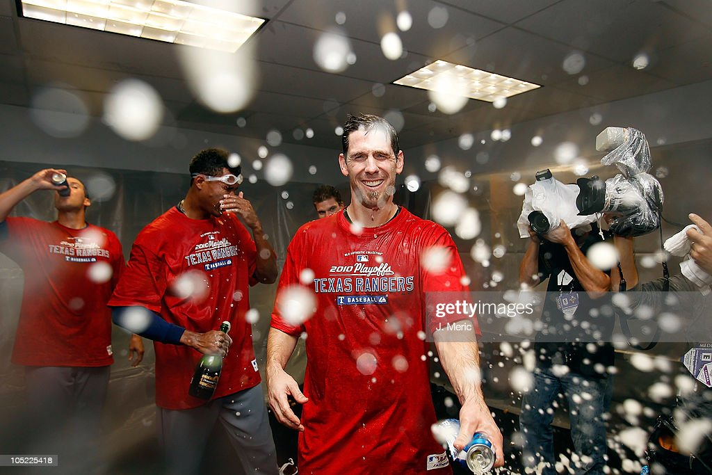 Pitcher Cliff Lee of the Texas Rangers celebrates his team's victory over the Tampa Bay Rays in Game 5 of the ALDS at Tropicana Field on October 12...