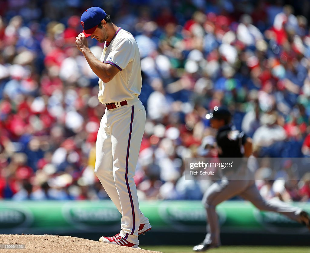 Pitcher <a gi-track='captionPersonalityLinkClicked' href=/galleries/search?phrase=Cole+Hamels&family=editorial&specificpeople=565675 ng-click='$event.stopPropagation()'>Cole Hamels</a> #35 of the Philadelphia Phillies looks down as Derek Dietrich #51 of Miami Marlins circles the basses after hitting a home run in the fourth inning of a game on June 5, 2013 at Citizens Bank Park in Philadelphia, Pennsylvania.
