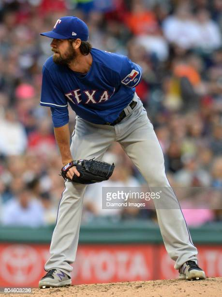Pitcher Cole Hamels of the Texas Rangers reads signs from home plate in the bottom of the third inning of a game on June 26 2017 against the...