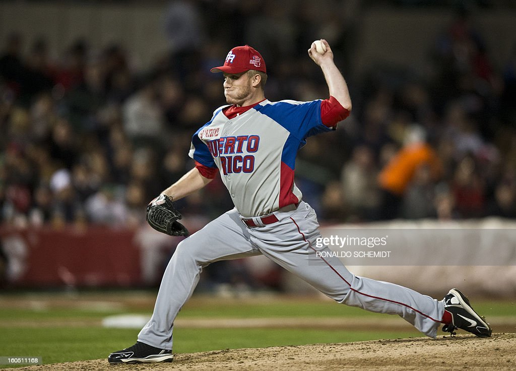 Pitcher Cole McCurry of Criollos de Caguas of Puerto Rico, pitches against Yaquis de Obregon of Mexico, at the Sonora Stadium, during the 2013 Baseball Caribbean Series, on February 1, 2013, in Hermosillo, Sonora State, northern Mexico. AFP PHOTO/Ronaldo Schemidt