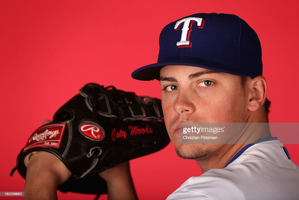 Pitcher Coty Woods #60 of the Texas Rangers poses for a portrait during spring training photo day at Surprise Stadium on February 20, 2013 in Surprise, Arizona.