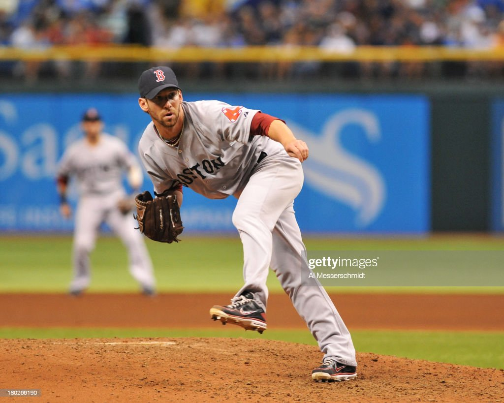 Pitcher <a gi-track='captionPersonalityLinkClicked' href=/galleries/search?phrase=Craig+Breslow&family=editorial&specificpeople=836367 ng-click='$event.stopPropagation()'>Craig Breslow</a> #32 of the Boston Red Sox throws in relief against the Tampa Bay Rays September 10, 2013 at Tropicana Field in St. Petersburg, Florida.