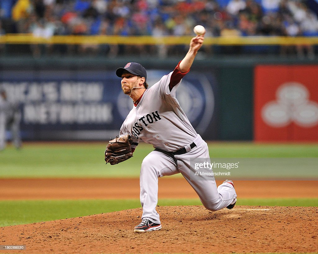 Pitcher Craig Breslow #32 of the Boston Red Sox throws in relief against the Tampa Bay Rays September 10, 2013 at Tropicana Field in St. Petersburg, Florida.