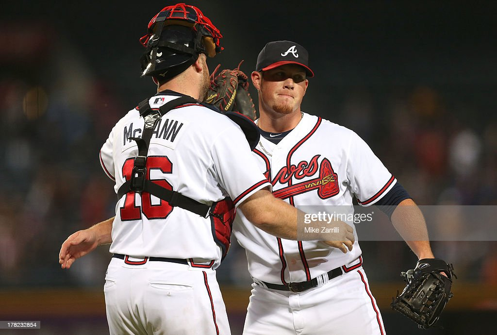 Pitcher <a gi-track='captionPersonalityLinkClicked' href=/galleries/search?phrase=Craig+Kimbrel&family=editorial&specificpeople=6795784 ng-click='$event.stopPropagation()'>Craig Kimbrel</a> #46 of the Atlanta Braves congratulates teammate and catcher <a gi-track='captionPersonalityLinkClicked' href=/galleries/search?phrase=Brian+McCann+-+Baseball+Player&family=editorial&specificpeople=593065 ng-click='$event.stopPropagation()'>Brian McCann</a> #16 after the game against the Cleveland Indians at Turner Field on August 27, 2013 in Atlanta, Georgia.