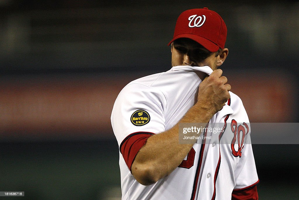 Pitcher <a gi-track='captionPersonalityLinkClicked' href=/galleries/search?phrase=Craig+Stammen&family=editorial&specificpeople=5897564 ng-click='$event.stopPropagation()'>Craig Stammen</a> #35 of the Washington Nationals heads to the dugout after recording three outs in a scoreless seventh inning against the Miami Marlins in game 2 of their day-night doubleheader at Nationals Park on September 22, 2013 in Washington, DC.