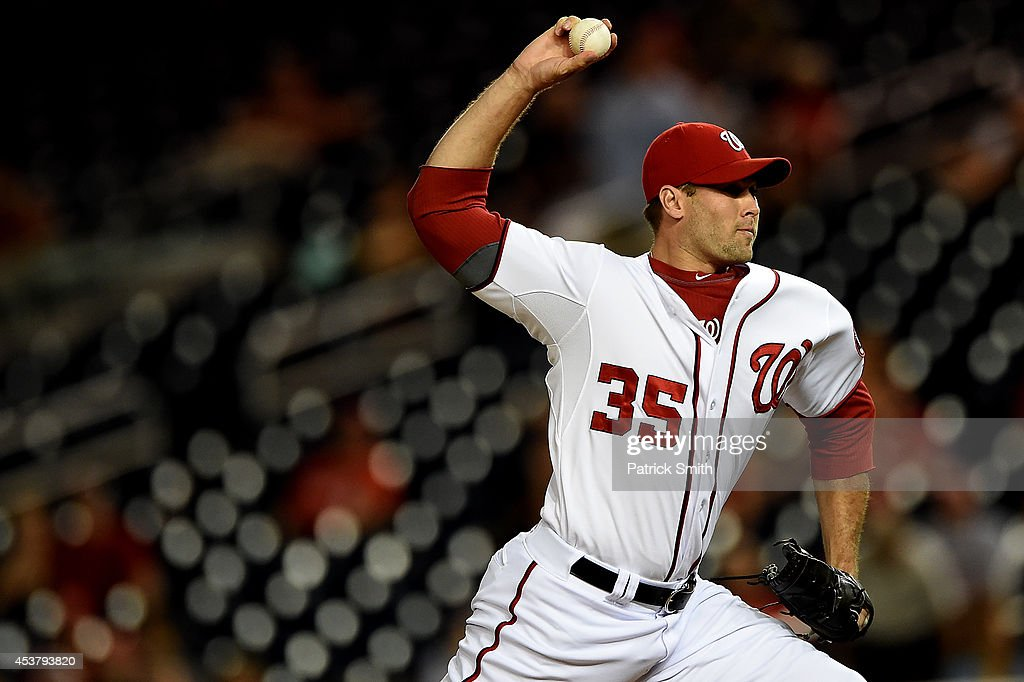 Pitcher <a gi-track='captionPersonalityLinkClicked' href=/galleries/search?phrase=Craig+Stammen&family=editorial&specificpeople=5897564 ng-click='$event.stopPropagation()'>Craig Stammen</a> #35 of the Washington Nationals works the eleventh inning against the Arizona Diamondbacks at Nationals Park on August 18, 2014 in Washington, DC. The Washington Nationals won, 5-4, in the eleventh inning.