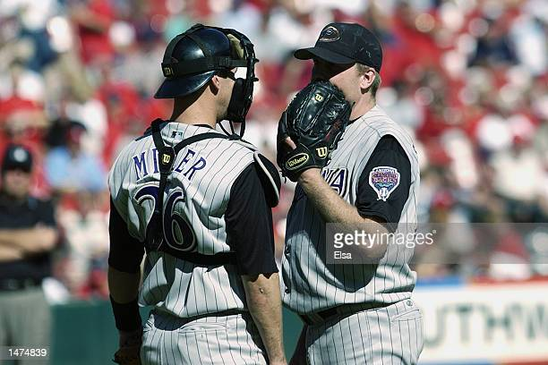 Pitcher Curt Schilling of the Arizona Diamondbacks talks to catcher Damian Miller during the MLB game against the St Louis Cardinals at Busch Stadium...