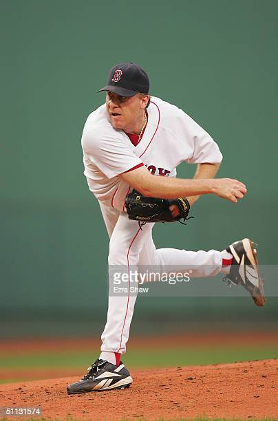 Pitcher Curt Schilling of the Boston Red Sox delivers a pitch during the game against the New York Yankees at Fenway Park on July 23 2004 in Boston...